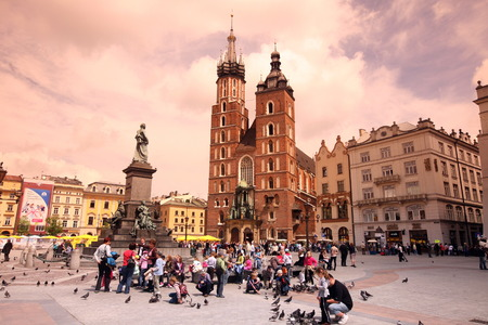 rynek: The Rynek Glowny place with the Marien-Church in the Old Town of Krakow in sueden of Poland.