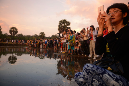 tourismus: Tourists at the Angkor Wat in the Temple City of Angkor near the City of Siem Riep in the west of Cambodia.