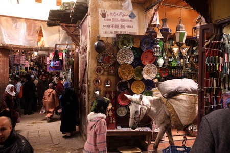 a smal Market Road in the medina of old City in the historical town of Fes in Morocco in north Africa.