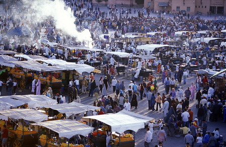 tracht: The Streetfood and Nightlife at the Djemma del Fna Square in the old town of Marrakesh in Morocco in North Africa.