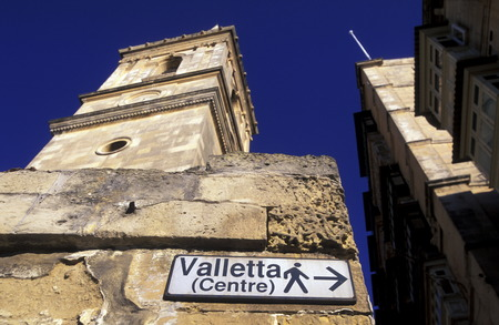 Reisen: A smal road in the centre of the Old Town of the city of Valletta on the Island of Malta in the Mediterranean Sea in Europe.