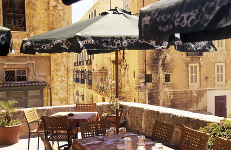 smal: A smal road in the centre of the Old Town of the city of Valletta on the Island of Malta in the Mediterranean Sea in Europe.