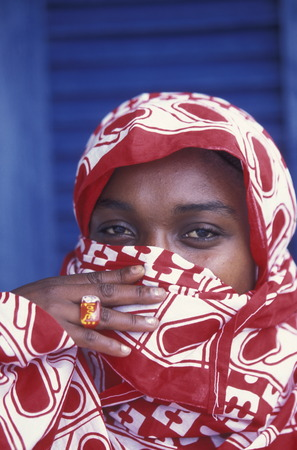 comores: a women in the city of Moutsamudu on the Island of Anjouan on the Comoros Ilands in the Indian Ocean in Africa.    Editorial
