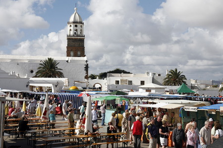 sunday market: the sunday market in the old town of Teguise on the Island of Lanzarote on the Canary Islands of Spain in the Atlantic Ocean. on the Island of Lanzarote on the Canary Islands of Spain in the Atlantic Ocean.  Editorial