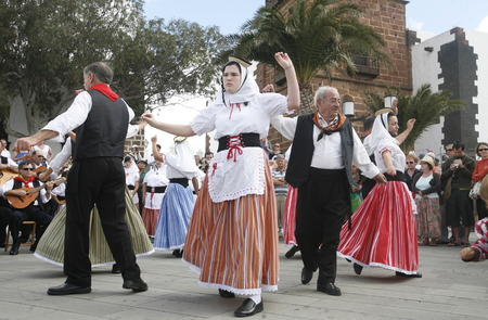 tracht: a traditional Dance in the old town of Teguise on the Island of Lanzarote on the Canary Islands of Spain in the Atlantic Ocean. on the Island of Lanzarote on the Canary Islands of Spain in the Atlantic Ocean.