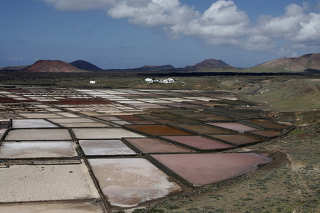 salina: The Salinas in the Laguna of El Charco on the Island of Lanzarote on the Canary Islands of Spain in the Atlantic Ocean.  Stock Photo