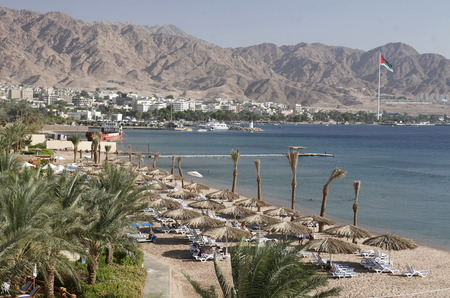 the coast with a Beach in the city of Aqaba on the red sea in Jordan in the middle east. Редакционное