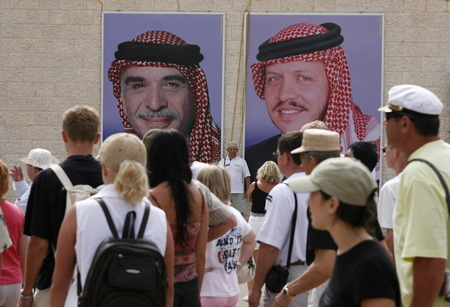 Pictures of the King Hussein, left, and his son and new King Abdullah, right, in the Village of Wadi Musa near the Temple city of Petra in Jordan in the middle east.