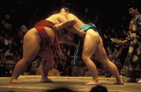 wrestling: a sumo fight in the sumo arena in the City center of Tokyo in Japan in Asia,