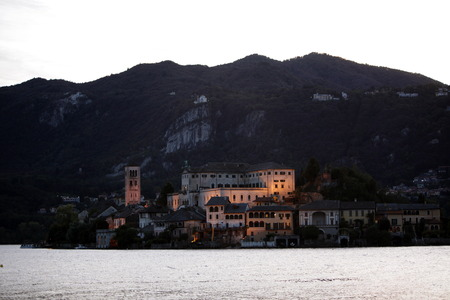 italien: The Isla San Giulio in the Ortasee outside of the Fishingvillage of Orta on the Lake Orta in the Lombardia  in north Italy.