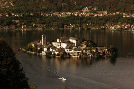 orta: The Isla San Giulio in the Ortasee outside of the Fishingvillage of Orta on the Lake Orta in the Lombardia  in north Italy.