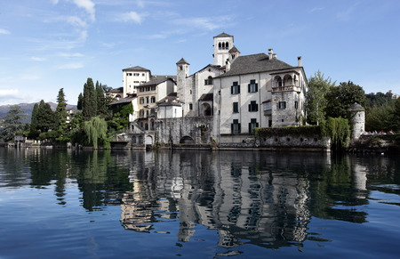 orta: The church of Isola San Giulio in the Ortasee outside of the Fishingvillage of Orta on the Lake Orta in the Lombardia  in north Italy.  Stock Photo