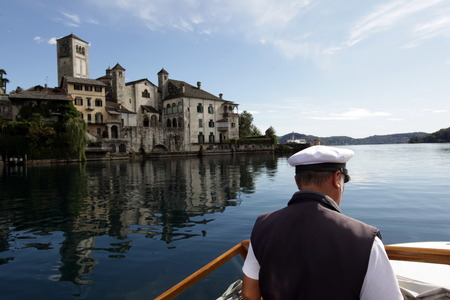 orta: The church of Isola San Giulio Orta in the outside of the Fishing Village of Orta on the Lake Orta in the Lombardia in north Italy. Editorial