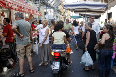 italien: the fegetable and food Market in the old Town of Catania in Sicily in south Italy in Europe.