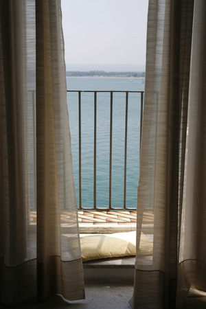chear: a Balcony at the seaside in the old town of Siracusa in Sicily in south Italy in Europe. Stock Photo
