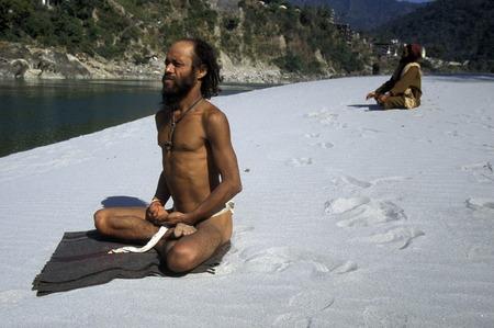 uttar pradesh: two men on the Ganges River in the town of Rishikesh in the Province Uttar Pradesh in India.