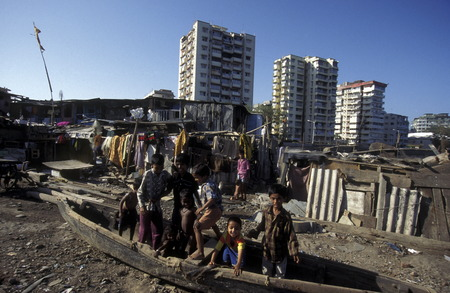 one of the slums in the city of Mumbai or Bombai in India.