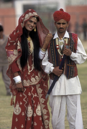 bikaner: a couple, a men is dresst a women, at the kamel Festival in the town of Bikaner in the province Rajasthan in India. Editorial