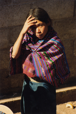 indios: people in traditional clotes in the Village of  San Cristobal in Guatemala in central America. Editorial