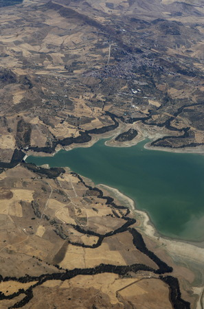 wasser: the air view allround the east part of Sicily near the Town of Catania in Sicily in south Italy in Europe.