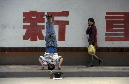 a men ask for money in the city of Chongqing in the province of Sichuan in China in east asia.