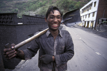 three gorges dam: the coal workers in the village of Fengjie in the three gorges valley up of the three gorges dam project in the province of hubei in china.