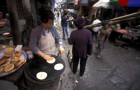 three gorges: the market in the city of wushan on the yangzee river near the three gorges valley up of the three gorges dam project in the province of hubei in china.