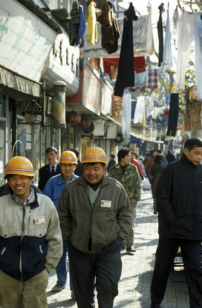 migrant: worker in the old town in the City of Shanghai in China in east asia.