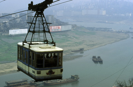 ropeway: the cable car on the way over the yangzee River in the city of Chongqing in the province of Sichuan in China in east asia.