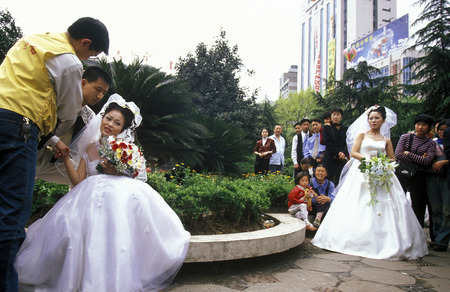 three gorges dam: a wedding in the city of wushan on the yangzee river near the three gorges valley up of the three gorges dam project in the province of hubei in china.