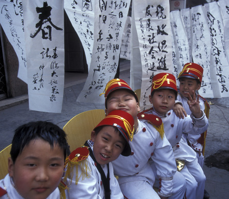 three gorges dam: a child music band in the city of wushan on the yangzee river near the three gorges valley up of the three gorges dam project in the province of hubei in china. Editorial