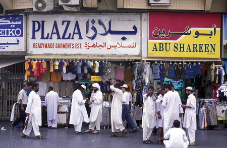 a shopping street in the souq or Market in the old town in the city of Dubai in the Arab Emirates in the Gulf of Arabia.