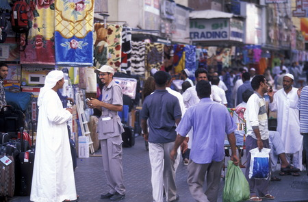 souq: a shopping street in the souq or Market in the old town in the city of Dubai in the Arab Emirates in the Gulf of Arabia.