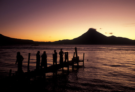 The Lake Atitlan mit the Volcanos of Toliman and San Pedro in the back at the Town of Panajachel in Guatemala in central America.