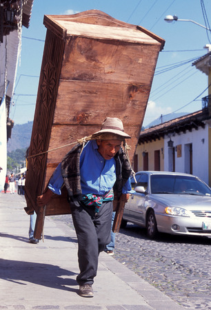 indios: a men works in the old town in the city of Antigua in Guatemala in central America.