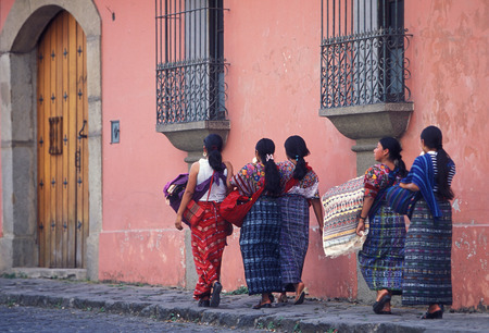 indios: indio women in the old town in the city of Antigua in Guatemala in central America.