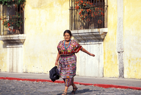 indios: a indio women in the old town in the city of Antigua in Guatemala in central America.