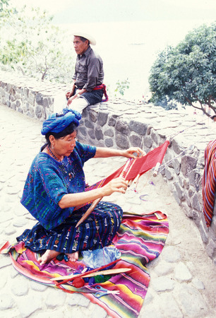 arbeit: a women works in traditional clotes in the Village of  Panajachel in Guatemala in central America.