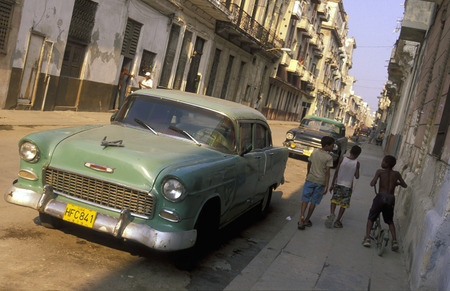 old cars in the old townl of the city of Havana on Cuba in the caribbean sea.