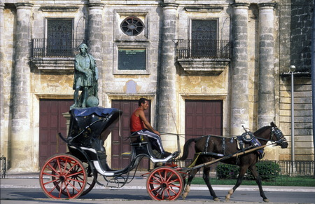horse cart: a horse cart Taxi transport in the old town of cardenas in the provine of Matanzas on Cuba in the caribbean sea.