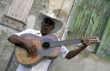 a Salsa Music Band on the Parce Cespedes in the city of Santiago de Cuba on Cuba in the caribbean sea.