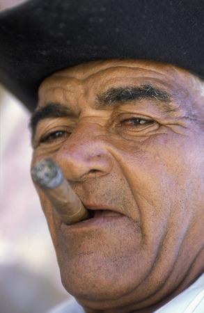 musik: a signor with a cigar in the city of Santiago de Cuba on Cuba in the caribbean sea.