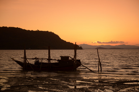 andaman sea: the sunset at the Harbour at the coast of the Andaman sea of Myeik in the south in Myanmar in Southeastasia.
