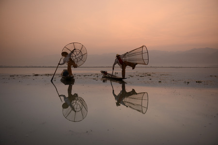 landschaft: Fishermen at sunrise in the Landscape on the Inle Lake in the Shan State in the east of Myanmar in Southeastasia.