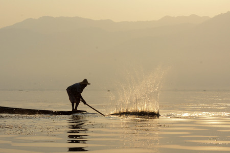 fishingboat: A fishingboat on the Lake Inle near the town of Nyaungshwe at the Inle Lake in the Shan State in the east of Myanmar in Southeastasia.