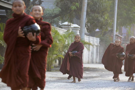streetlife: Buddhist Monks on a road in the town of Nyaungshwe at the Inle Lake in the Shan State in the east of Myanmar in Southeastasia. Editorial