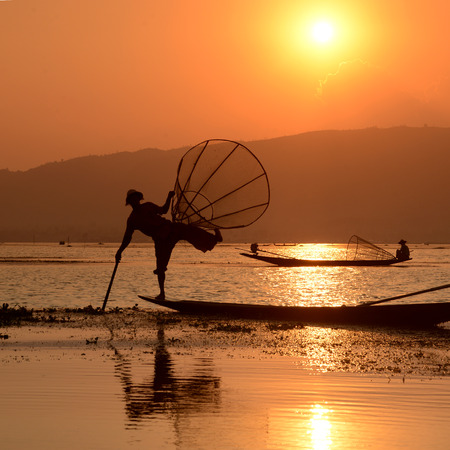 landschaft: Fishermen at sunset in the Landscape on the Inle Lake in the Shan State in the east of Myanmar in Southeastasia.