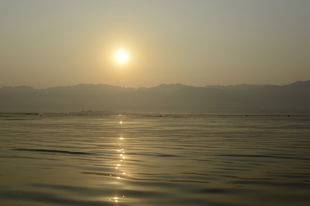 landschaft: the Landscape at sunrise on the Inle Lake in the Shan State in the east of Myanmar in Southeastasia.