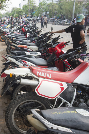 motobike: Motobike Parking at the Thingyan Water Festival at the Myanmar New Year in the city centre of Mandalay in Manamar in Southeastasia.