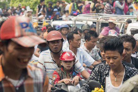 trafic: People at the Waterparty at the Thingyan Water Festival at the Myanmar New Year in the city centre of Mandalay in Manamar in Southeastasia.